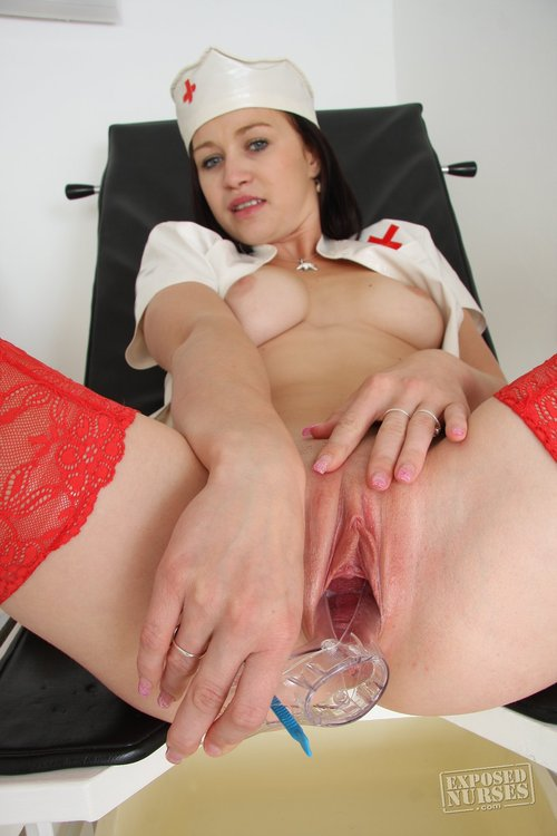 Brunette with natural tits shows red stockings and nurse uniform