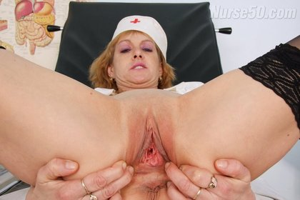 Redhead Nurse Nora Unbuttons Uniform and Fucks with Dildo